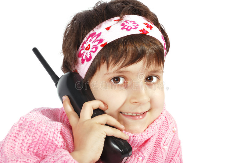 Conversa do miúdo para o telefone foto de stock
