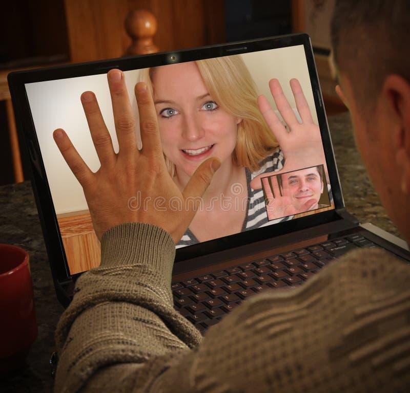 Conversa dos povos da câmara de vídeo do portátil imagem de stock