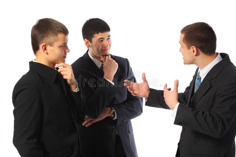Conversa nova de três homens de negócios imagens de stock royalty free