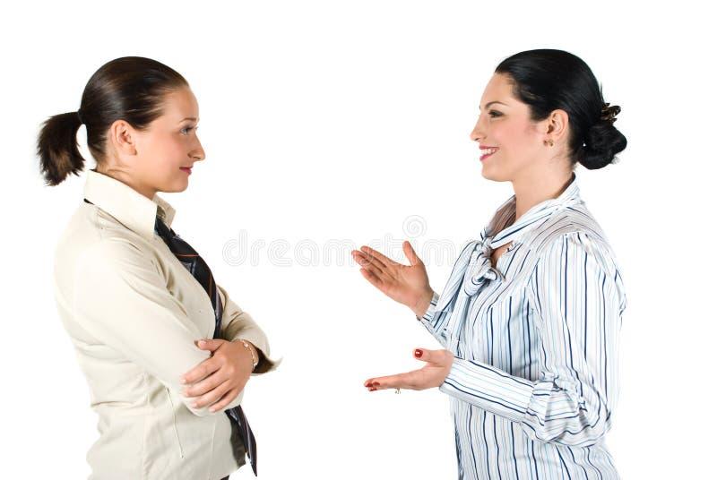 Conversación de la mujer de negocios imagenes de archivo