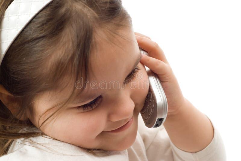 Conversación telefónica del niño fotos de archivo