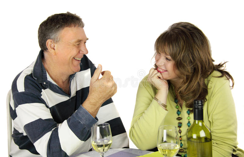 The Conversation. Middle aged couple having a conversation over lunch royalty free stock photo