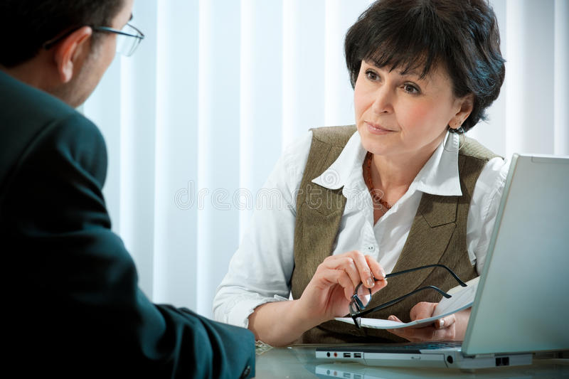 Conversation. Mid-adult businessman in a conversation with the consultant or psychologist