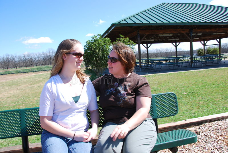 Conversation. Two women are talking at a local park about their personal issues stock photos