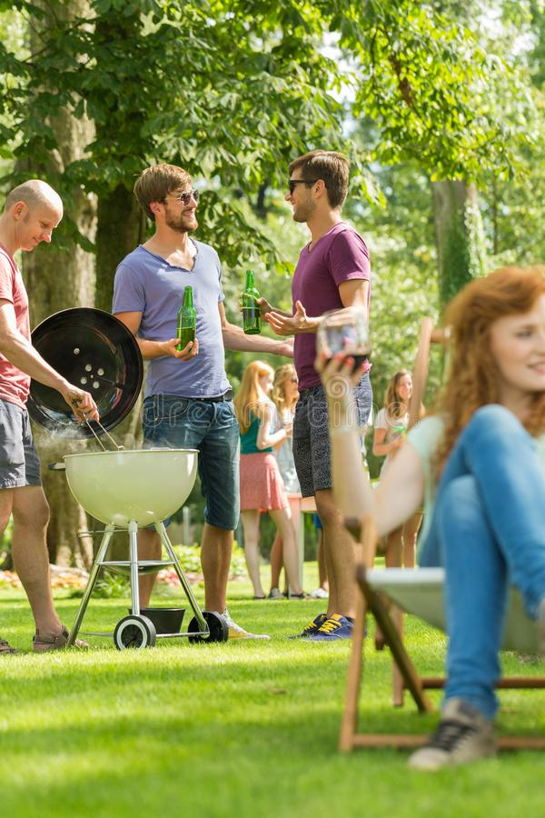 Conversation by the barbecue royalty free stock image