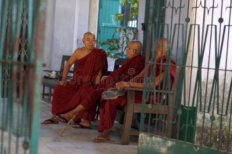 Monks in Yangon, Burma, Asia. Conversation of Burman monks in Yangon, Asia stock photography