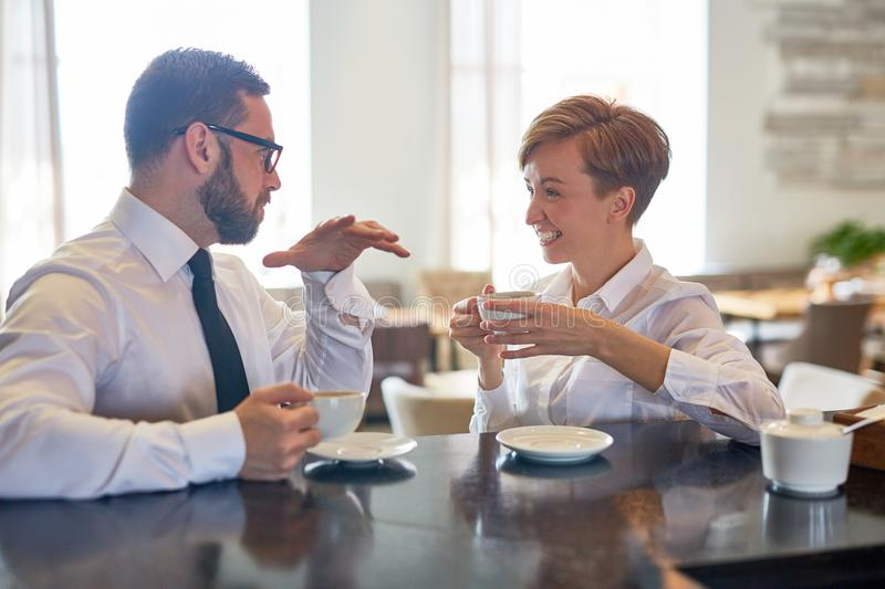 Conversation in cafe stock photography
