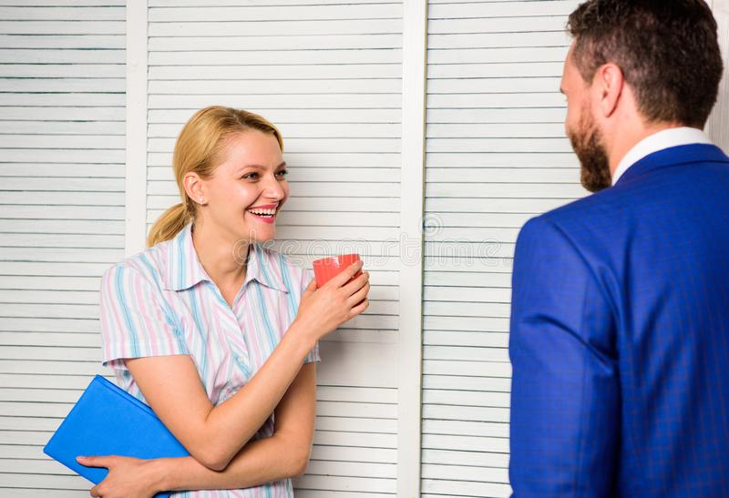 Conversation between colleagues. Boss and worker discuss working plan. Relations at workplace. Friendship and personal. Attitude to employee. Office coffee royalty free stock photography