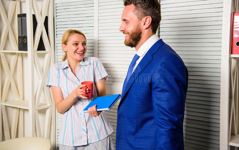 Conversation between colleagues. Relations at workplace. Friendship and personal attitude to employee. Office coffee. Break. Colleagues spend time coffee break royalty free stock photography