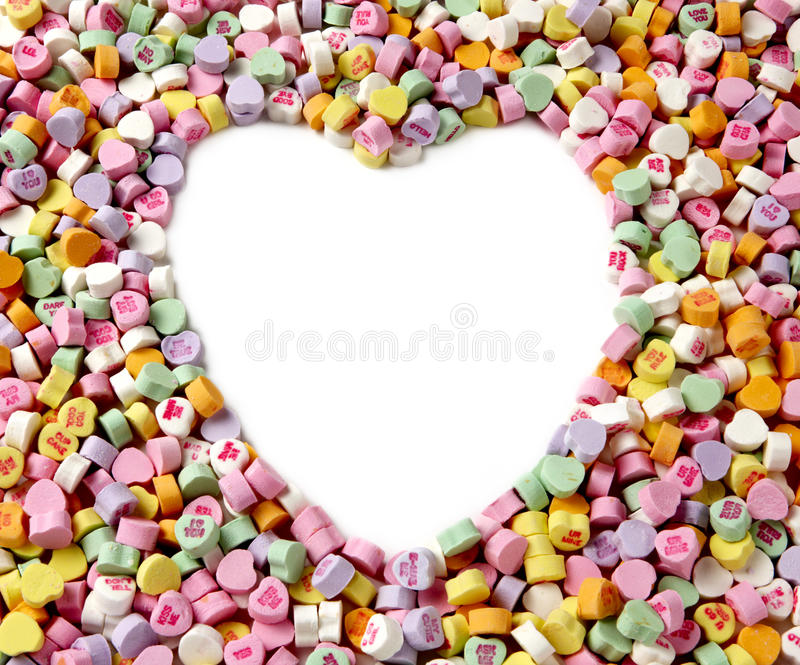 Conversation hearts frame. Frame is filled with colorful conversation hearts including shape of large heart in middle with space for message stock photos