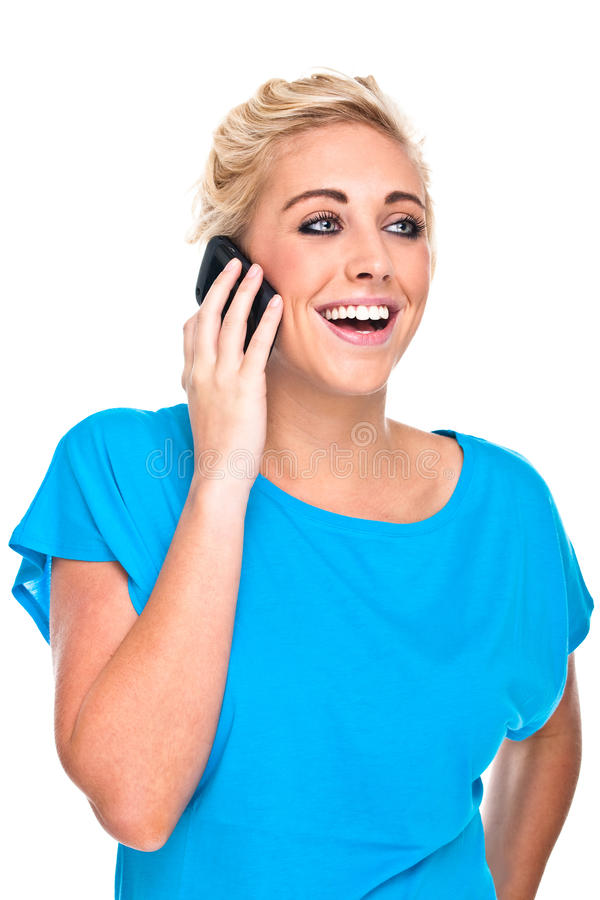 Conversation heureuse de femme attirante sur le téléphone portable images libres de droits