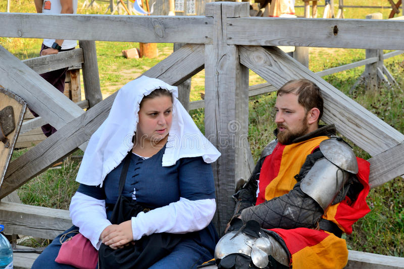Conversation knight and his lady before the battle. International Championship on the historical medieval battle Call of heroes. It passes near Kiev, in the royalty free stock images