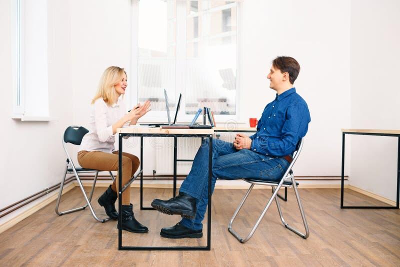 Conversation between office workers stock photography