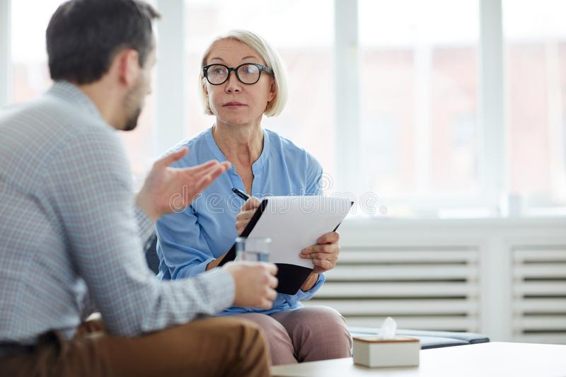 Conversation with patient stock image