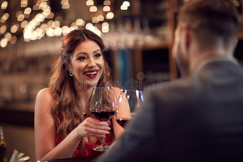 Conversation in romantic ambience. Conversation between couple in romantic restaurant stock photos