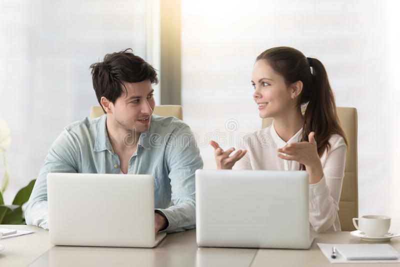 Conversation between two colleagues or business partners sitting royalty free stock photography