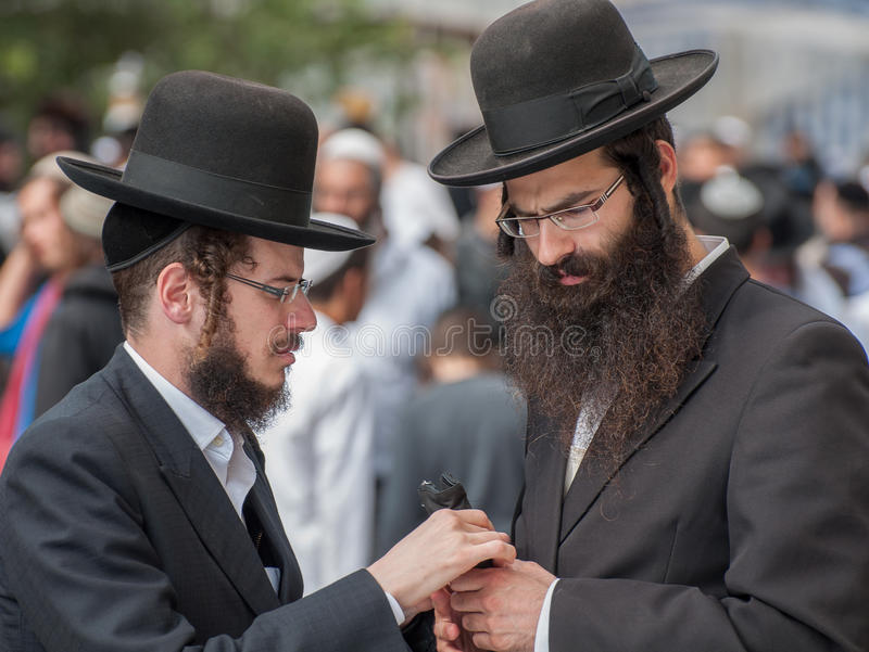 Conversation between two Hasidic Jews. Uman, Ukraine - 2 October 2016: Every year, thousands of Orthodox Bratslav Hasidic Jews from different countries gather royalty free stock photos