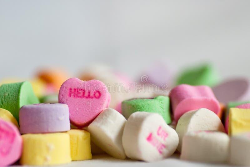 Conversation Valentine Hearts Hello. A macro shot of Valentine's Day candy conversation hearts saying hello royalty free stock photography