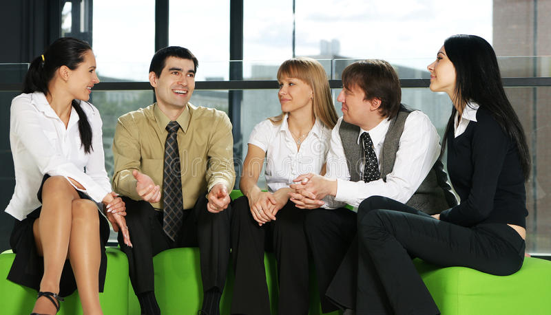 Conversation of a young business team stock photo