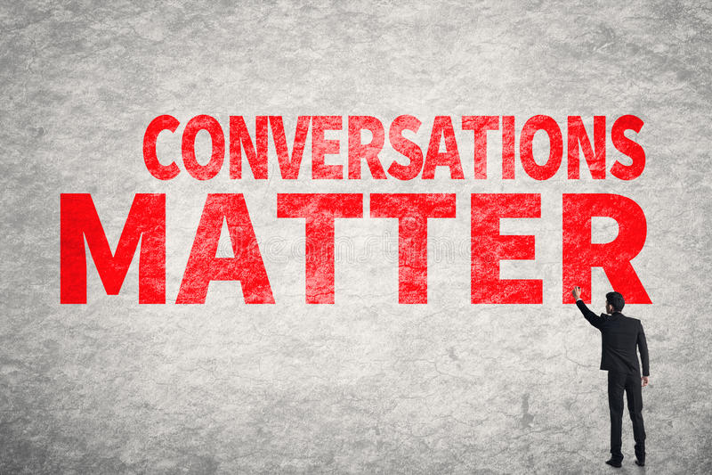 Conversations Matter. Asian business man write words on wall, Conversations Matter royalty free stock photo