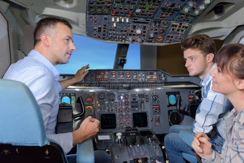 Conversazione nella cabina di pilotaggio fotografia stock