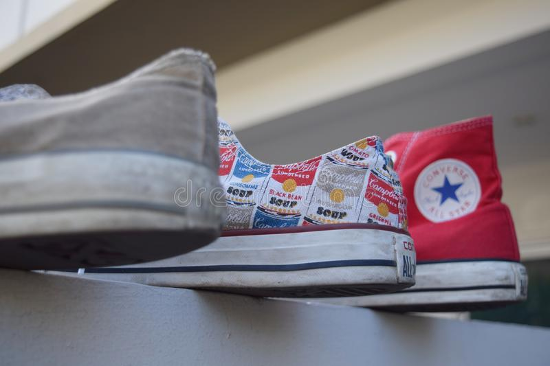 Converse shoes of mine. NFirst is white Chuck Taylor all star` 70nSecond is Chuck Taylor All Star x Andy WarholnThird is red Chuck Taylor all star HI classic royalty free stock photo