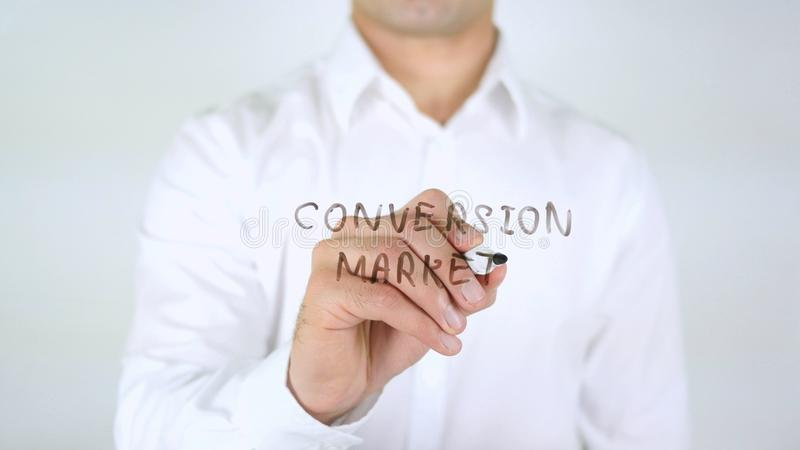 Conversion Market, Man Writing on Glass, Handwritten royalty free stock photos