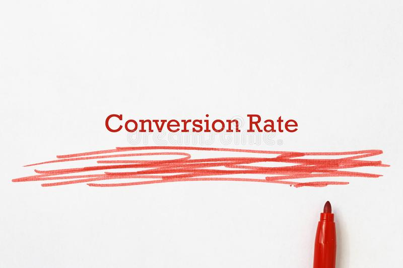 Conversion rate on paper. With pen royalty free stock image