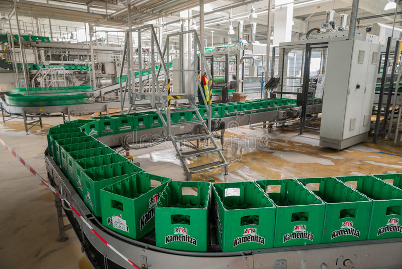 Conveyer belt with empty plastic packs in a brewery. A conveyer belt with packs for beer is seen during production process in the Molson Coors Kamenitza beer royalty free stock images