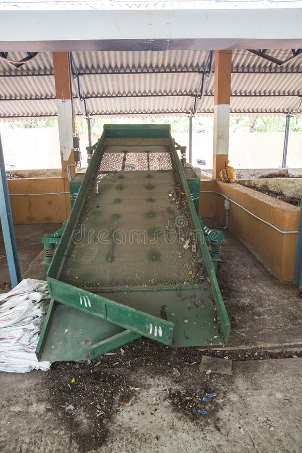 Conveyor belt for disposing compost, the final form of recycled waste in a recycling waste to energy and composting factory. stock image