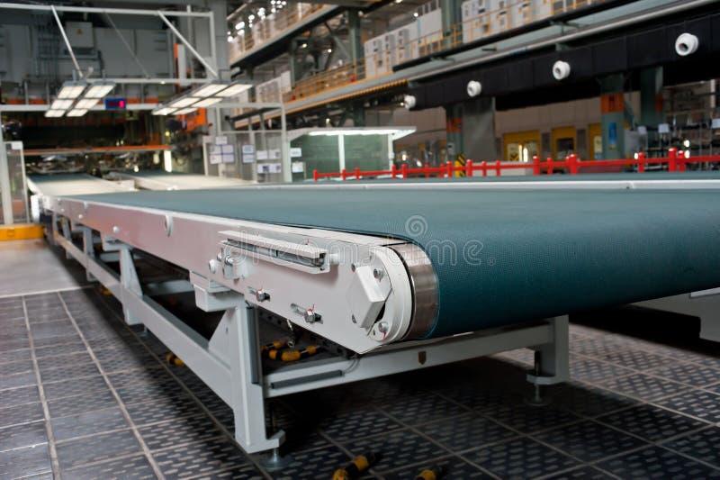 Conveyor belt in the workshop stock photography