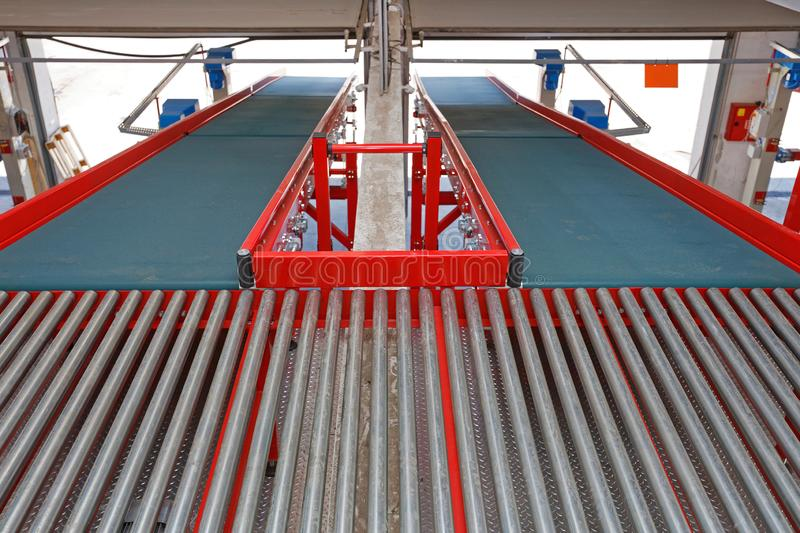 Conveyor Belts Ramps. Two Conveyor Belts at Ramp for Cargo Shipping in Distribution Warehouse stock photos