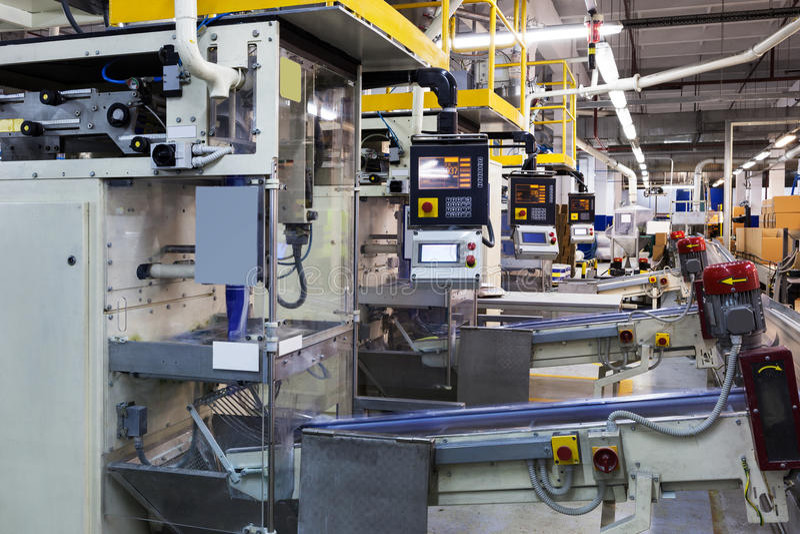 Conveyor in modern plant stock image