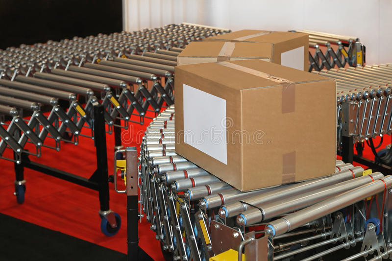 Conveyor rollers box. Powered conveyor rollers for box transfer in factory stock images