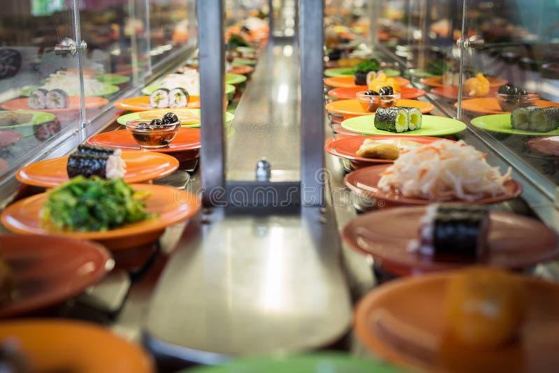 Conveyor sushi belt stock photo