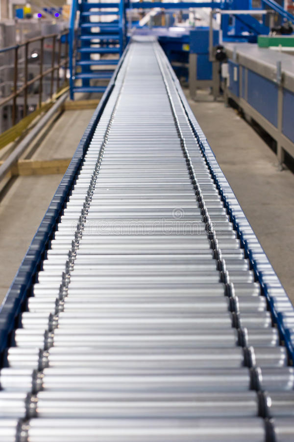 Conveyor. A conveyor system made up of small rollers stock image