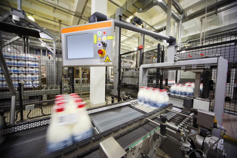 Conveyor with wrapped milk bottles at factory stock photo