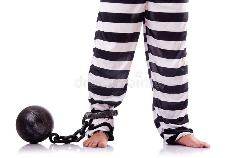 Convict criminal. In striped uniform stock photo