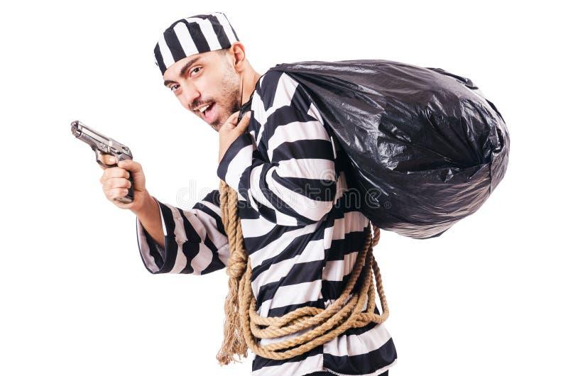 Convict criminal. In striped uniform stock photos