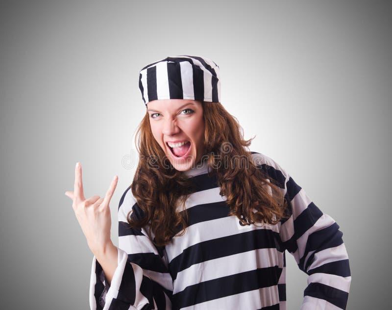 The convict criminal in striped uniform. Convict criminal in striped uniform royalty free stock photo