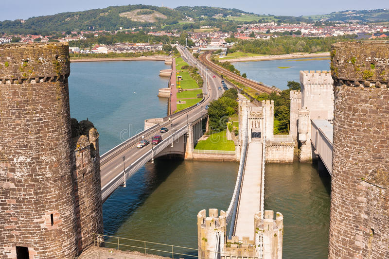 Conwy Castle and Three Bridges in Wales, UK. Overhead view from Conway Castle of three bridges spanning the Conwy River: the modern road bridge, the 19th century royalty free stock photo