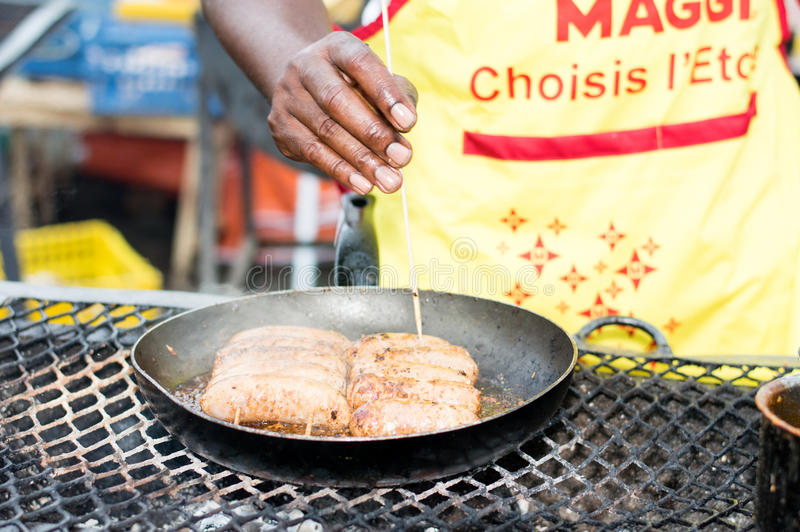 Cook the barbecue festival of Abidjan. royalty free stock photography