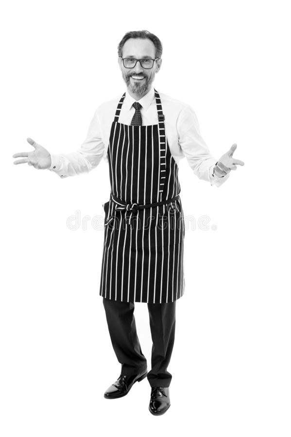 Cook barber or seller wearing apron. Bearded man in apron salesman. Master of household. Home cooking. Household duties stock images