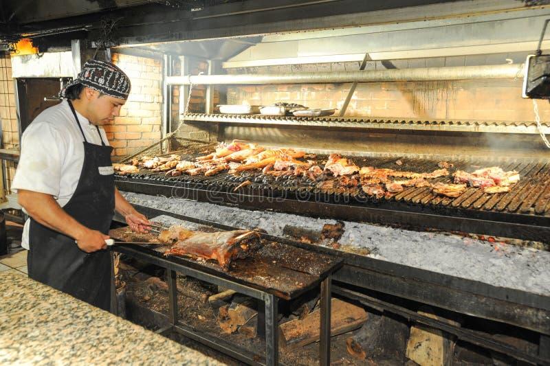 Cook on the bbq grill at a restaurant of mendoza for Silla 14 cafe resto mendoza mendoza