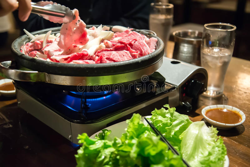 Cook beef in gas stove and vegatable( blurred vegatable). Cook beef in gas stove and vegatable( blurred vegatable, focus on beef stock photo