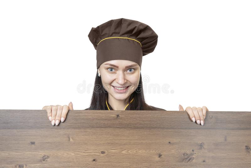 Cook behind a wooden board stock photos