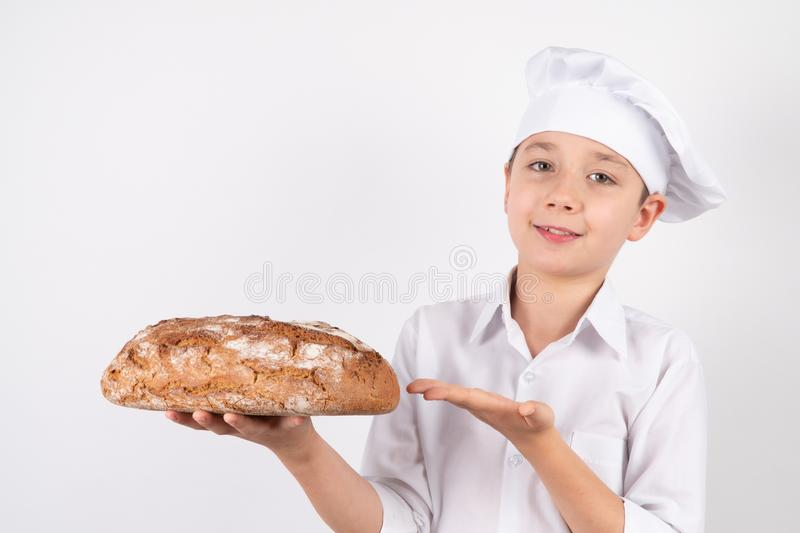 Cook Boy With Bread on white background stock photo