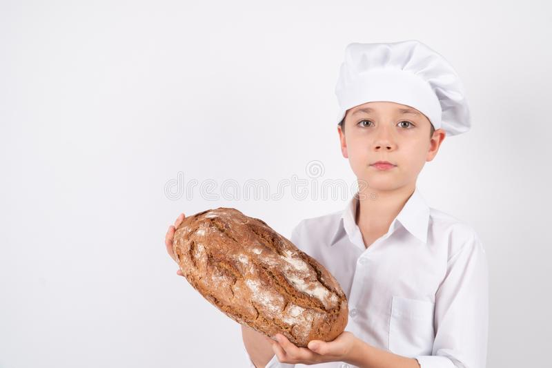 Cook Boy With Bread on white background royalty free stock image