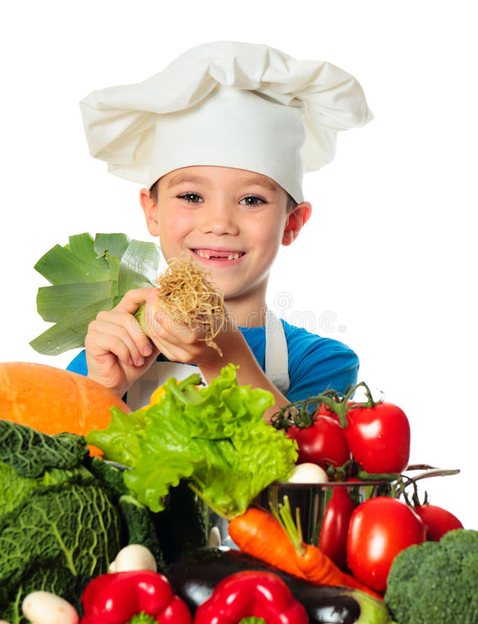 Cook boy. Six years old cook boy with different vegetables with leek in hand isolated on white royalty free stock photography