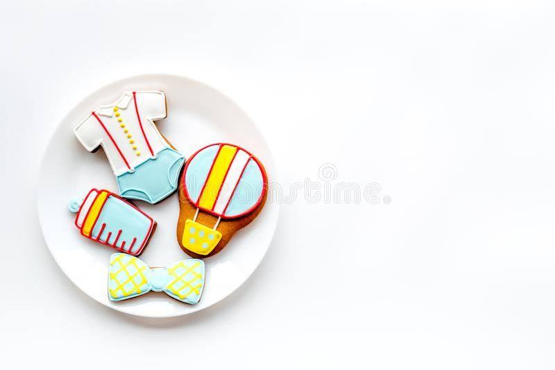 Cook gingerbread cookies on plate for baby shower on white background top view mockup. Cook gingerbread cookies on plate for baby shower on white desk background royalty free stock photo